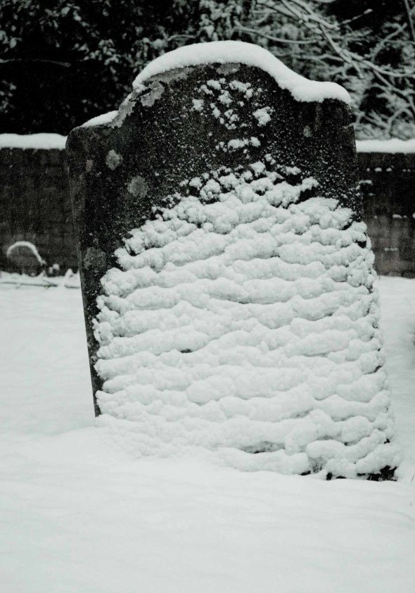 melting snow on grave