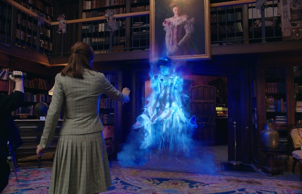 Abby (Melissa McCarthy) and Erin (Kristen Wiig) see the Gertrude the Ghost (Bess Rous) of Aldridge Mansion in Columbia Pictures' GHOSTBUSTERS.